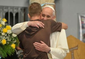 Pope_Francis_hugs_a_man_in_his_visit_to_a_rehab_hospital