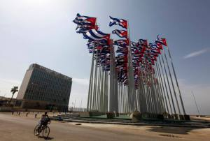 Man cycles past Interests Section Office of United States in Havana