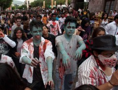 People dressed as zombies take part in an annual parade in Queretaro, north of Mexico City, July 30, 2011. Hundreds of people took part in the event on Saturday, now in its third year in Queretaro, to pay homage to the character typically depicted as the mindless walking dead with a penchant for human flesh and brains, made popular in movies, books and comics. REUTERS/Demian Chavez Hernandez (MEXICO - Tags: SOCIETY ODDLY)