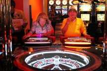 fl-roulette-laws-gamblingB - Yolanda Febles, left, and Abundio Febles play the new Roulette slot machine table at Magic City Casino in Miami, Florida on Monday, April 23, 2012. Sarah Dussault, Sun Sentinel