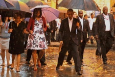 U.S. President Barack Obama steps over a puddle while touring Old Havana with his family, in Havana March 20, 2016. REUTERS/Carlos Barria - RTSBDLD